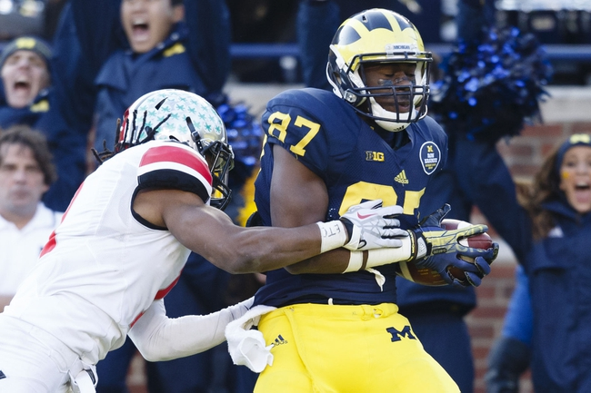 Nov 30, 2013; Ann Arbor, MI, USA; Michigan Wolverines tight end Devin Funchess (87) catches a pass for a touchdown in the fourth quarter against the Ohio State Buckeyes at Michigan Stadium. Ohio State won 42-41. Mandatory Credit: Rick Osentoski-USA TODAY Sports