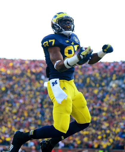 Nov 30, 2013; Ann Arbor, MI, USA; Michigan Wolverines tight end Devin Funchess (87) celebrates after catching a pass in the touchdown during the fourth quarter against the Ohio State Buckeyes at Michigan Stadium. Mandatory Credit: Andrew Weber-USA TODAY Sports