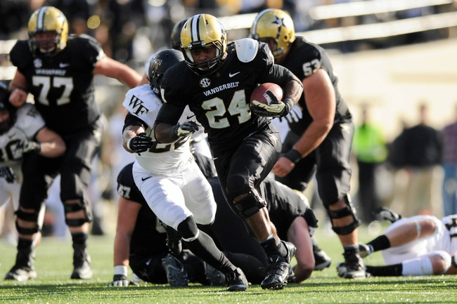Nov 30, 2013; Nashville, TN, USA; Vanderbilt Commodores running back Wesley Tate (24) runs the ball against the Wake Forest Demon Deacons during the second half at Vanderbilt Stadium. Vanderbilt won 23 to 21. Mandatory Credit: Randy Sartin-USA TODAY Sports
