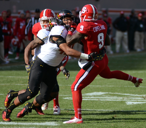 Nov 30, 2013; Raleigh, NC, USA; Maryland Terrapins linebacker Matt Robinson (40) tackles North Carolina State Wolfpack receiver Travares Copeland (9) during the first half at Carter Finley Stadium. Mandatory Credit: Rob Kinnan-USA TODAY Sports