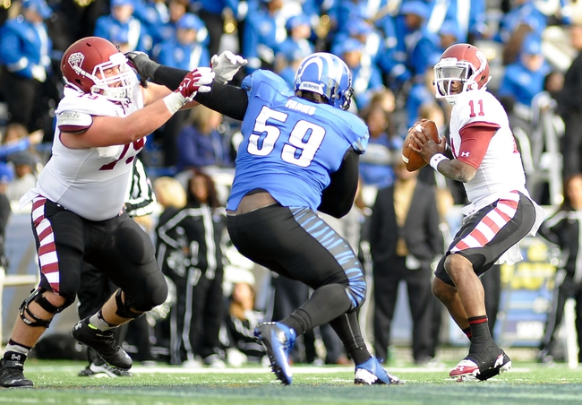 Nov 30, 2013; Memphis, TN, USA; Temple Owls quarterback P.J. Walker (11)  passes against the Memphis Tigers during the second half at Liberty Bowl Memorial. Temple Owls beat the Memphis Tigers 41-21. Mandatory Credit: