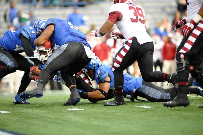 Nov 30, 2013; Memphis, TN, USA; Temple Owls running back Jamie Gilmore (26) is tackled by Memphis Tigers linebacker Leonard Pegues (53) and  linebacker Ryan Coleman (44) during the second half at Liberty Bowl Memorial. Temple Owls beat the Memphis Tigers 41-21. Mandatory Credit: Justin Ford-USA TODAY Sports