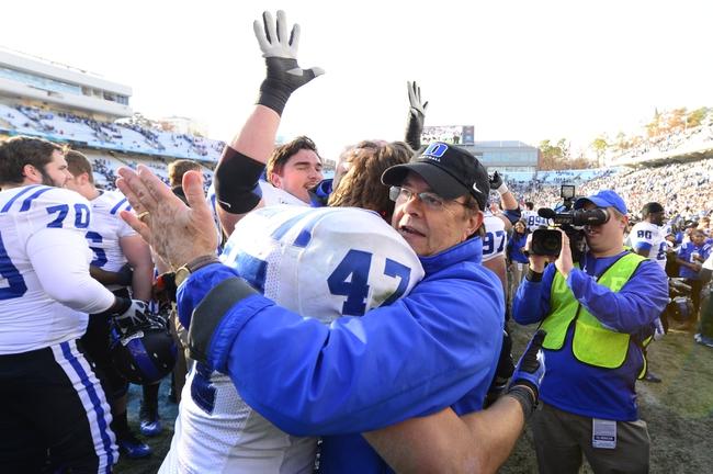 Nov 30, 2013; Chapel Hill, NC, USA;  Duke Blue Devils head coach David Cutcliff with linebacker David Helton (47) after the game. The Duke Blue Devils defeated the North Carolina Tar Heels 27-25 at Kenan Memorial Stadium. Mandatory Credit: Bob Donnan-USA TODAY Sports