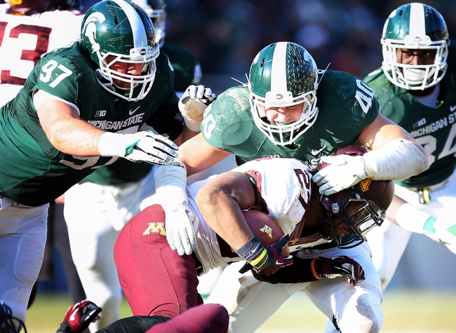 Nov 30, 2013; East Lansing, MI, USA; Minnesota Golden Gophers running back David Cobb (27) is tackled by Michigan State Spartans linebacker Max Bullough (40) during the 2nd half a game at Spartan Stadium.MSU won 14-3.  Mandatory Credit: Mike Carter-USA TODAY Sports