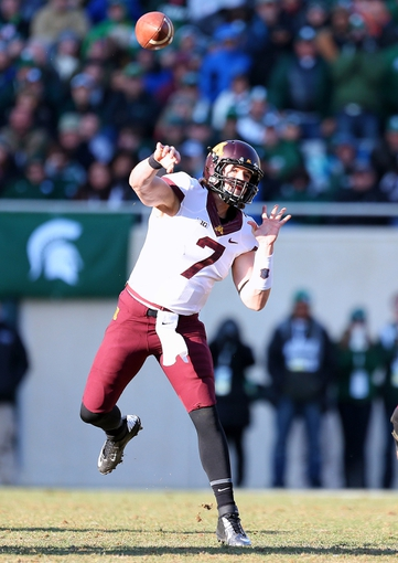 Nov 30, 2013; East Lansing, MI, USA; Minnesota Golden Gophers quarterback Mitch Leidner (7) attempts to throw the ball against the Michigan State Spartans during the 2nd half a game at Spartan Stadium. MSU won 14-3.  Mandatory Credit: Mike Carter-USA TODAY Sports