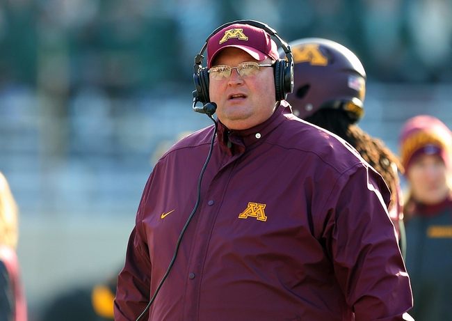 Nov 30, 2013; East Lansing, MI, USA; Minnesota Golden Gophers defensive coordinator Tracy Claeys walks sideline during the 2nd half against the Michigan State Spartans at Spartan Stadium. MSU won 14-3.  Mandatory Credit: Mike Carter-USA TODAY Sports