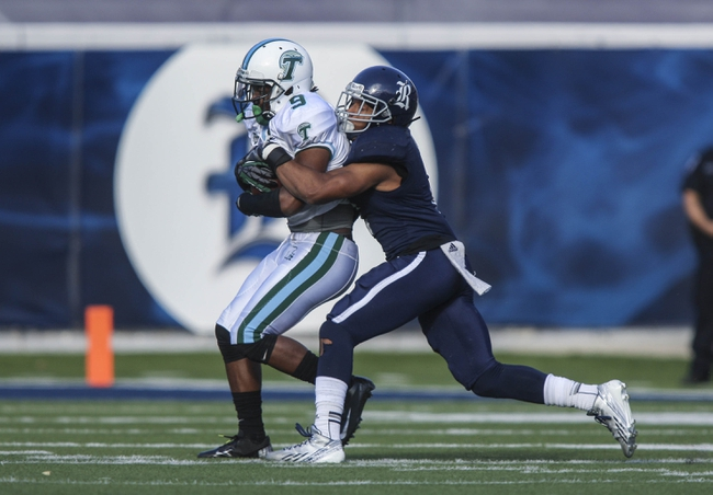 Nov 30, 2013; Houston, TX, USA; Tulane Green Wave wide receiver Kedrick Banks (9) makes a reception during the second quarter as Rice Owls safety Malcolm Hill (2) makes a tackle at Rice Stadium. Mandatory Credit: Troy Taormina-USA TODAY Sports