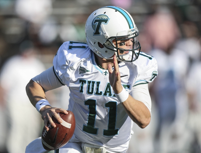 Nov 30, 2013; Houston, TX, USA; Tulane Green Wave quarterback Nick Montana (11) runs with the ball during the second quarter against the Rice Owls at Rice Stadium. Mandatory Credit: Troy Taormina-USA TODAY Sports