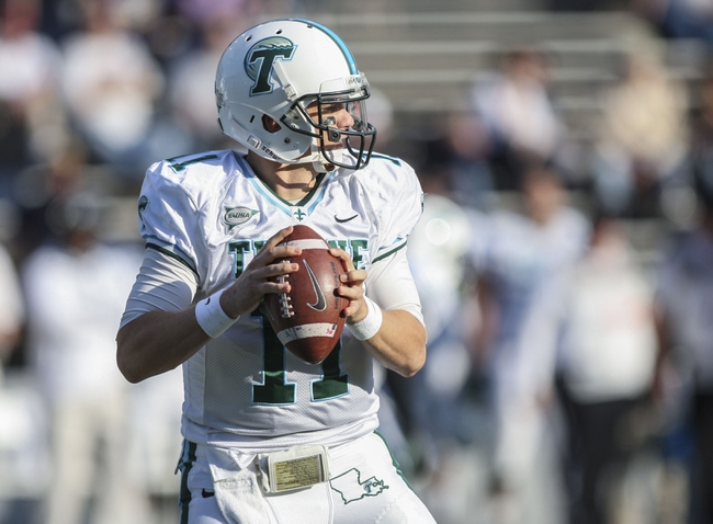 Nov 30, 2013; Houston, TX, USA; Tulane Green Wave quarterback Nick Montana (11) looks for an open receiver during the second quarter against the Rice Owls at Rice Stadium. Mandatory Credit: Troy Taormina-USA TODAY Sports