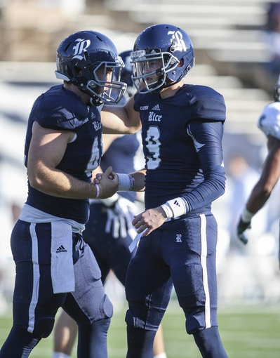Nov 30, 2013; Houston, TX, USA; Rice Owls kicker Chris Boswell (9) is congratulated after kicking a field goal during the second quarter against the Tulane Green Wave at Rice Stadium. Mandatory Credit: Troy Taormina-USA TODAY Sports