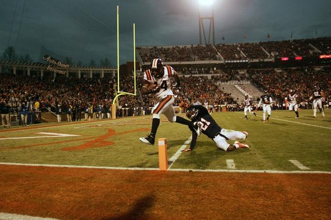 Nov 30, 2013; Charlottesville, VA, USA; Virginia Tech Hokies running back Trey Edmunds (14) scores a touchdown against the Virginia Cavaliers in the second quarter at Scott Stadium. Mandatory Credit: Geoff Burke-USA TODAY Sports
