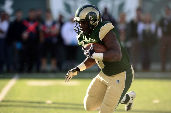 Nov 30, 2013; Fort Collins, CO, USA; Colorado State Rams running back Chris Nwoke (6) carries in the fourth quarter against the Air Force Falcons at Hughes Stadium. The Rams defeated the Falcons 58-0. Mandatory Credit: Ron Chenoy-USA TODAY Sports
