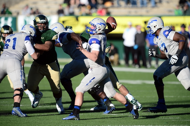 Nov 30, 2013; Fort Collins, CO, USA; Air Force Falcons quarterback Karson Roberts (16) prepares to pass in the fourth quarter against the Air Force Falcons at Hughes Stadium. The Rams defeated the Falcons 58-0. Mandatory Credit: Ron Chenoy-USA TODAY Sports