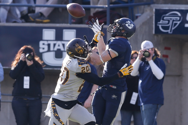 Nov 30, 2013; Logan, UT, USA; Utah State Aggies wide receiver Travis Van Leeuwen (7) tries to catch the ball while being defended by Wyoming Cowboys cornerback Blair Burns (20) during the third quarter at Romney Stadium. Utah State Aggies won the game 35-7. Mandatory Credit: Chris Nicoll-USA TODAY Sports