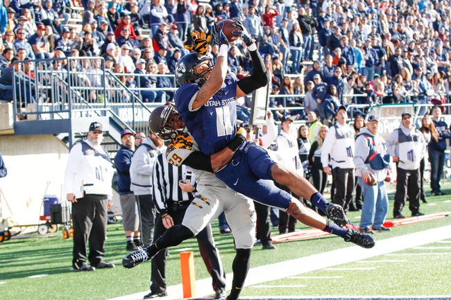 Nov 30, 2013; Logan, UT, USA; Utah State Aggies wide receiver Brandon Swindall (11) catches the ball in the end zone and scores a touchdown while being defended by Wyoming Cowboys defensive back Tim Hayes (29) during the third quarter at Romney Stadium. Utah State Aggies won the game 35-7. Mandatory Credit: Chris Nicoll-USA TODAY Sports