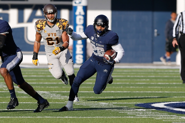 Nov 30, 2013; Logan, UT, USA; Utah State Aggies running back Joey DeMartino (28) rushes up the field against the Wyoming Cowboys in the fourth quarter at Romney Stadium. Utah State Aggies won the game 35-7. Mandatory Credit: Chris Nicoll-USA TODAY Sports