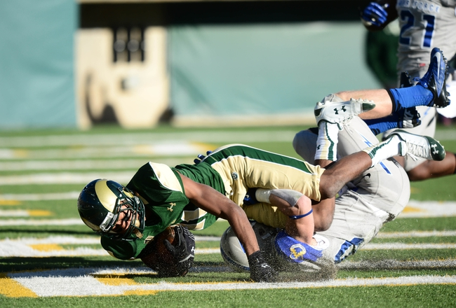 Nov 30, 2013; Fort Collins, CO, USA; Colorado State Rams wide receiver Jordon Vaden (11) scores a touchdown while being defended by Air Force Falcons defensive back Gavin McHenry (20) in the third quarter at Hughes Stadium. The Rams defeated the Falcons 58-13. Mandatory Credit: Ron Chenoy-USA TODAY Sports