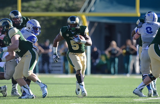 Nov 30, 2013; Fort Collins, CO, USA; Colorado State Rams running back Kapri Bibbs (5) carries for a gain in the third quarter against the Air Force Falcons at Hughes Stadium. The Rams defeated the Falcons 58-13. Mandatory Credit: Ron Chenoy-USA TODAY Sports