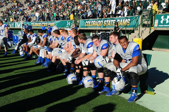 Nov 30, 2013; Fort Collins, CO, USA; Members of the Air Force Falcons sit on the bench following a score by the Colorado State Rams in the third quarter at Hughes Stadium. The Rams defeated the Falcons 58-13. Mandatory Credit: Ron Chenoy-USA TODAY Sports