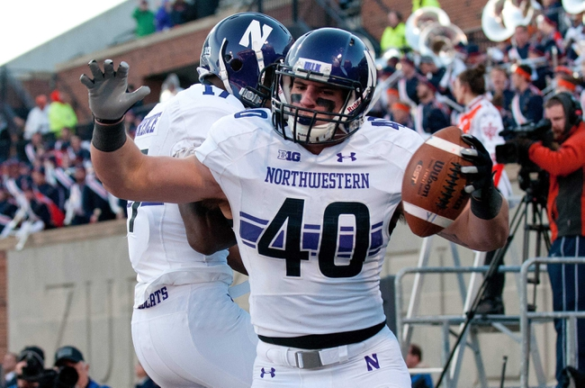 Nov 30, 2013; Champaign, IL, USA;  Northwestern Wildcats wide receiver Rashad Lawrence (17) celebrates with fullback Dan Vitale (40) after Vitale's touchdown during the second quarter at Memorial Stadium. Mandatory Credit: Bradley Leeb-USA TODAY Sports