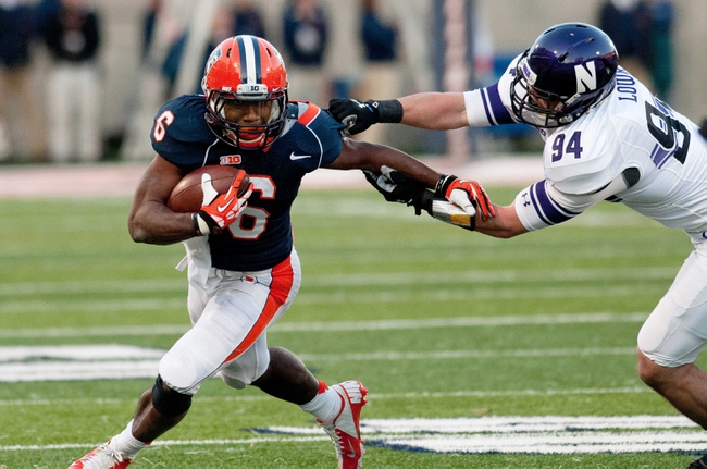 Nov 30, 2013; Champaign, IL, USA;  Illinois Fighting Illini running back Josh Ferguson (6) tries to avoid a tackle by Northwestern Wildcats defensive lineman Dean Lowry (94) during the second quarter at Memorial Stadium. Mandatory Credit: Bradley Leeb-USA TODAY Sports