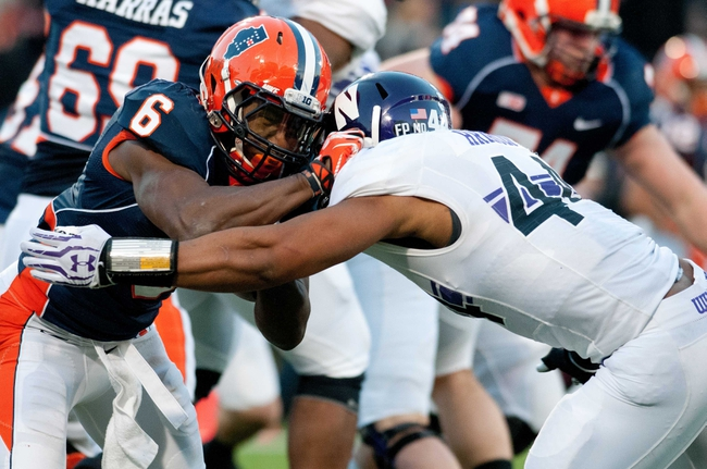 Nov 30, 2013; Champaign, IL, USA;  Illinois Fighting Illini running back Josh Ferguson (6) is tackled by Northwestern Wildcats linebacker Chi Chi Ariguzo (44) during the second quarter at Memorial Stadium. Mandatory Credit: Bradley Leeb-USA TODAY Sports