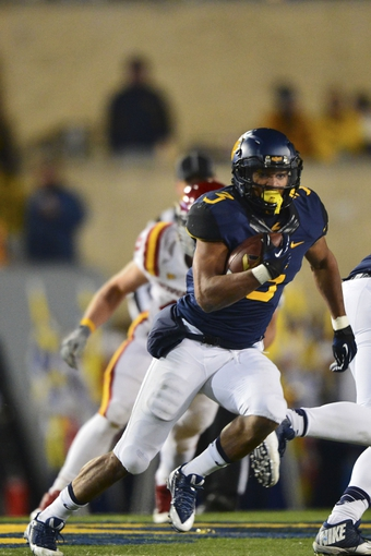 Nov 30, 2013; Morgantown, WV, USA; West Virginia Mountaineers running back Charles Sims (3) runs with the ball during the second quarter of the game against the Iowa State Cyclones at Milan Puskar Stadium. Mandatory Credit: Tommy Gilligan-USA TODAY Sports