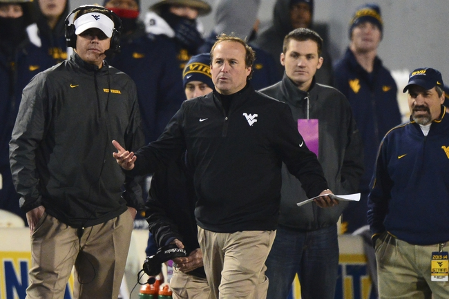 Nov 30, 2013; Morgantown, WV, USA; West Virginia Mountaineers head coach Dana Holgorsen reacts to a call made by the officials during the second quarter of the game against the Iowa State Cyclones at Milan Puskar Stadium. Mandatory Credit: Tommy Gilligan-USA TODAY Sports