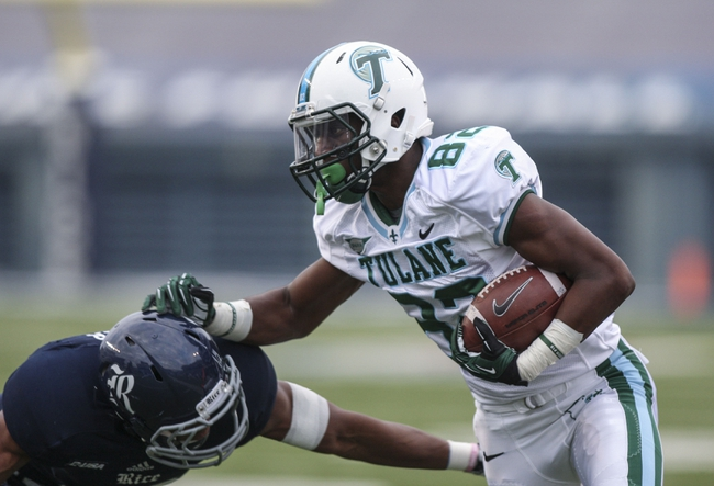 Nov 30, 2013; Houston, TX, USA; Tulane Green Wave wide receiver Xavier Rush (82) makes a reception during the third quarter against the Rice Owls at Rice Stadium. Mandatory Credit: Troy Taormina-USA TODAY Sports