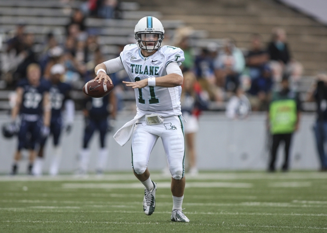 Nov 30, 2013; Houston, TX, USA; Tulane Green Wave quarterback Nick Montana (11) looks for an open receiver during the third quarter against the Rice Owls at Rice Stadium. Mandatory Credit: Troy Taormina-USA TODAY Sports