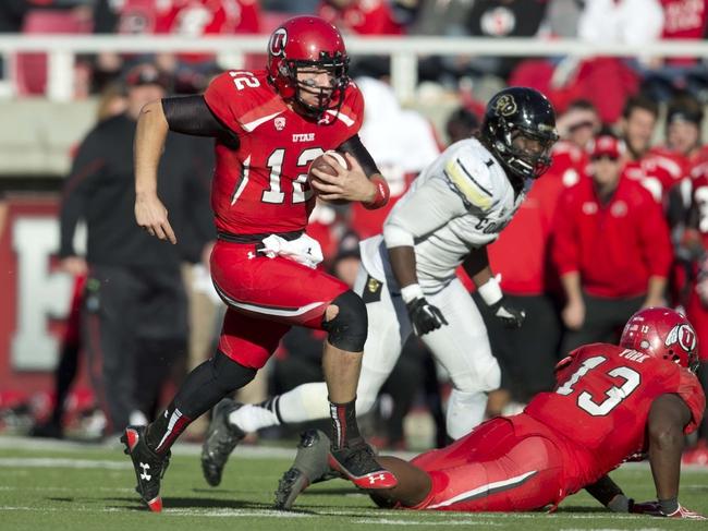 Nov 30, 2013; Salt Lake City, UT, USA; Utah Utes quarterback Adam Schulz (12) runs the ball during the second half against the Colorado Buffaloes at Rice-Eccles Stadium. Utah won 24-17. Mandatory Credit: Russ Isabella-USA TODAY Sports