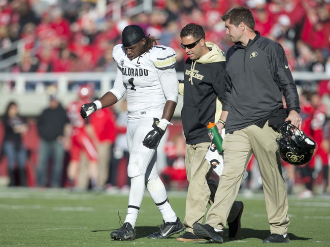 Nov 30, 2013; Salt Lake City, UT, USA; Colorado Buffaloes linebacker Derrick Webb (1) is helped off the field after being injured during the second half against the Utah Utes at Rice-Eccles Stadium. Utah won 24-17. Mandatory Credit: Russ Isabella-USA TODAY Sports