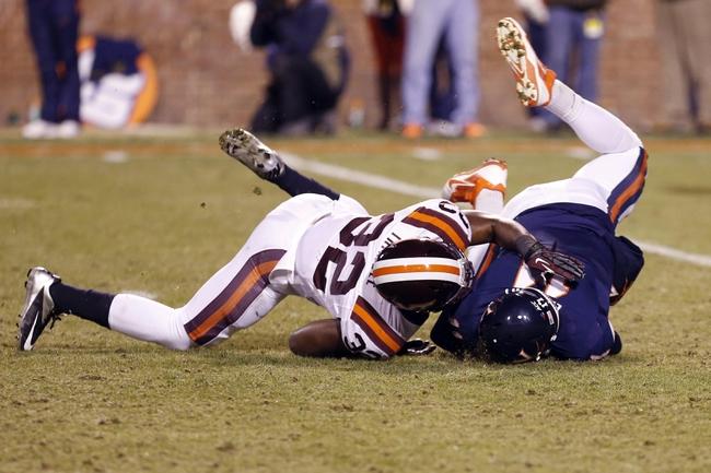 Nov 30, 2013; Charlottesville, VA, USA; Virginia Tech Hokies linebacker Josh Trimble (32) sacks Virginia Cavaliers quarterback Greyson Lambert (11) in the fourth quarter at Scott Stadium. The Hokies won 16-6. Mandatory Credit: Geoff Burke-USA TODAY Sports