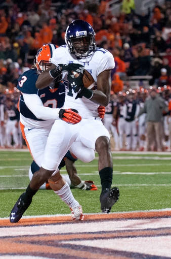Nov 30, 2013; Champaign, IL, USA;  Northwestern Wildcats wide receiver Rashad Lawrence (17) scores a touchdown during the fourth quarter against the Illinois Fighting Illini at Memorial Stadium. Northwestern won 37-34.  Mandatory Credit: Bradley Leeb-USA TODAY Sports