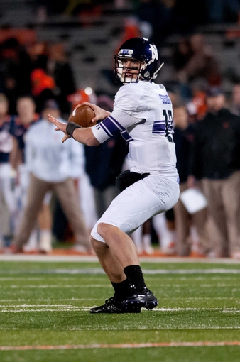 Nov 30, 2013; Champaign, IL, USA;  Northwestern Wildcats quarterback Trevor Siemian (13) throws the ball during the third quarter against the Illinois Fighting Illini at Memorial Stadium. Northwestern won 37-34.  Mandatory Credit: Bradley Leeb-USA TODAY Sports