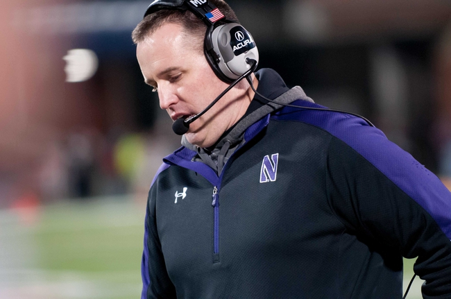 Nov 30, 2013; Champaign, IL, USA;  Northwestern Wildcats head coach Pat Fitzgerald during the fourth quarter against the Illinois Fighting Illini at Memorial Stadium. Northwestern won 37-34.  Mandatory Credit: Bradley Leeb-USA TODAY Sports