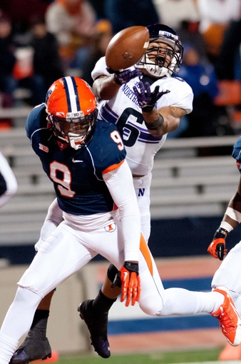 Nov 30, 2013; Champaign, IL, USA;  Northwestern Wildcats wide receiver Tony Jones (6) has a pass broken up by Illinois Fighting Illini defensive back Earnest Thomas III (9) during the fourth quarter at Memorial Stadium. Northwestern won 37-34.  Mandatory Credit: Bradley Leeb-USA TODAY Sports