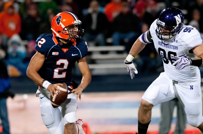 Nov 30, 2013; Champaign, IL, USA;  Illinois Fighting Illini quarterback Nathan Scheelhaase (2) is pursued by Northwestern Wildcats defensive lineman Max Chapman (96) during the fourth quarter at Memorial Stadium. Northwestern won 37-34.  Mandatory Credit: Bradley Leeb-USA TODAY Sports
