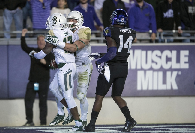 Nov 30, 2013; Fort Worth, TX, USA; Baylor Bears safety Terrell Burt (13) and linebacker Eddie Lackey (5) celebrate Burts interception against the TCU Horned Frogs at Amon G. Carter Stadium. The Bears defeated the Horned Frogs 41-38. Mandatory Credit: Jerome Miron-USA TODAY Sports