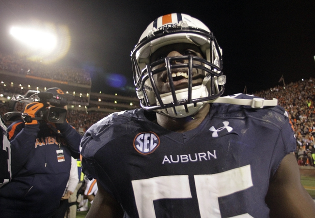 Nov 30, 2013; Auburn, AL, USA; Auburn Tigers defensive end Carl Lawson (55) reacts after defeating the Alabama Crimson Tide during the fourth quarter at Jordan Hare Stadium. Auburn Tigers won 34-28. Mandatory Credit: John Reed-USA TODAY Sports
