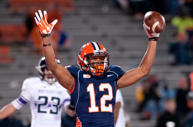 Nov 30, 2013; Champaign, IL, USA;  Illinois Fighting Illini wide receiver Miles Osei (12) reacts after his touchdown during the fourth quarter against the Northwestern Wildcats at Memorial Stadium. Northwestern won 37-34.  Mandatory Credit: Bradley Leeb-USA TODAY Sports