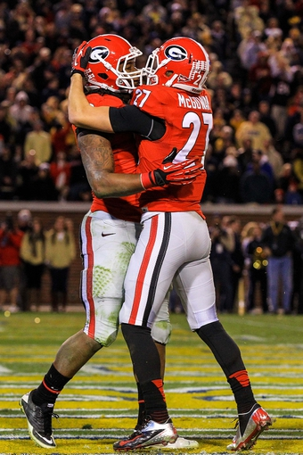 Nov 30, 2013; Atlanta, GA, USA; Georgia Bulldogs running back Todd Gurley (3) celebrates the game winning touchdown with wide receiver Rhett McGowan (27) in overtime against the Georgia Tech Yellow Jackets at Bobby Dodd Stadium. Georgia won 41-34 in overtime. Mandatory Credit: Daniel Shirey-USA TODAY Sports