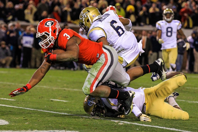 Nov 30, 2013; Atlanta, GA, USA; Georgia Bulldogs running back Todd Gurley (3) scores the winning touchdown over Georgia Tech Yellow Jackets linebacker Daniel Drummond (30) and defensive back Chris Milton (6) at Bobby Dodd Stadium. Georgia won 41-34 in overtime. Mandatory Credit: Daniel Shirey-USA TODAY Sports