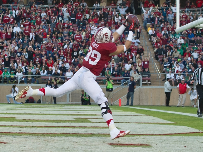 Nov 30, 2013; Stanford, CA, USA; Stanford Cardinal wide receiver Devon Cajuste (89) catches a pass for a touchdown in the first quarter against the Notre Dame Fighting Irish at Stanford Stadium. Mandatory Credit: Matt Cashore-USA TODAY Sports