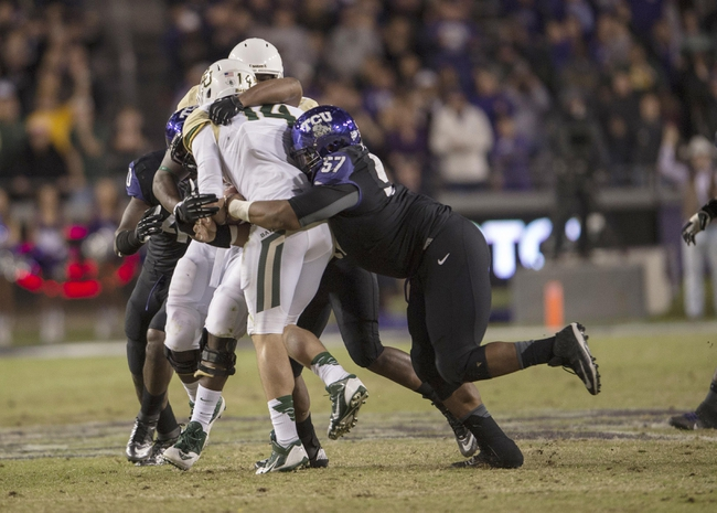 Nov 30, 2013; Fort Worth, TX, USA; TCU Horned Frogs defensive tackle Davion Pierson (57) sacks Baylor Bears quarterback Bryce Petty (14) during the second half at Amon G. Carter Stadium. The Bears defeated the Horned Frogs 41-38. Mandatory Credit: Jerome Miron-USA TODAY Sports