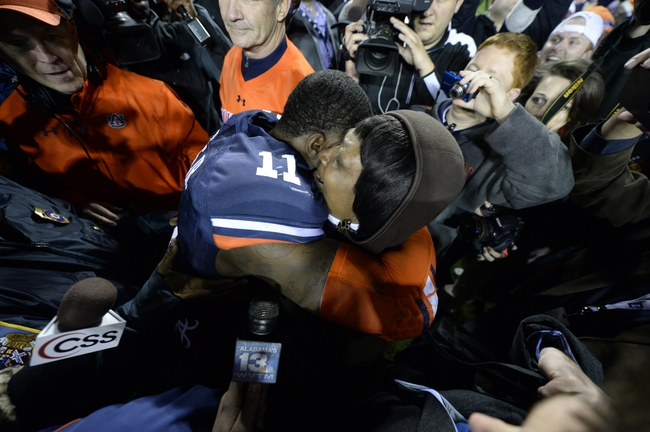Nov 30, 2013; Auburn, AL, USA; Auburn Tigers cornerback Chris Davis (11) hugs a fan following his 100 yard touchdown in the final second against the Alabama Crimson Tide during the fourth quarter at Jordan Hare Stadium. Auburn Tigers won 34-28. Mandatory Credit: John David Mercer-USA TODAY Sports