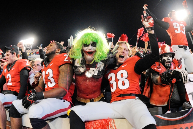 Nov 30, 2013; Atlanta, GA, USA; Georgia Bulldogs players celebrate after defeating the Georgia Tech Yellow Jackets at Bobby Dodd Stadium. Georgia defeated Georgia Tech 41-34 in overtime. Mandatory Credit: Dale Zanine-USA TODAY Sports