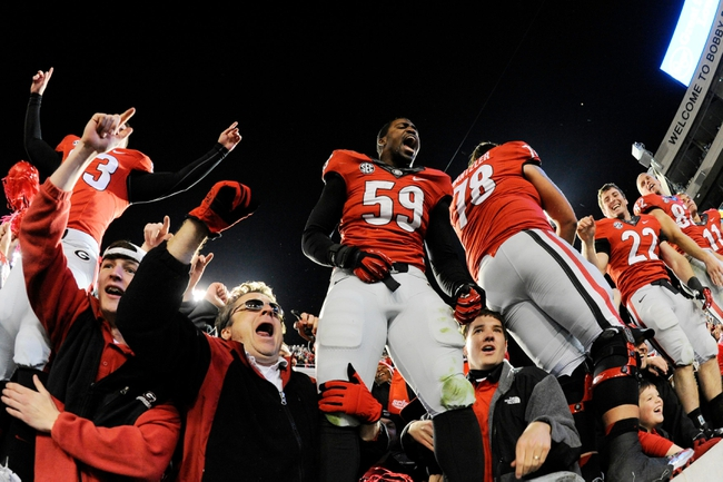 Nov 30, 2013; Atlanta, GA, USA; Georgia Bulldogs players celebrate with their fans after defeating the Georgia Tech Yellow Jackets at Bobby Dodd Stadium. Georgia defeated Georgia Tech 41-34 in overtime. Mandatory Credit: Dale Zanine-USA TODAY Sports
