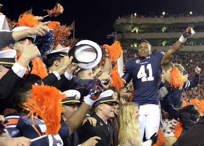 Nov 30, 2013; Auburn, AL, USA;  Auburn Tigers running back Patrick Lymon (41) celebrates following their victory over the Alabama Crimson Tide 34-28 after a 100 yard return of a missed field goal by  cornerback Chris Davis (11) with no time left in the game at Jordan Hare Stadium. Mandatory Credit: RVR Photos-USA TODAY Sports
