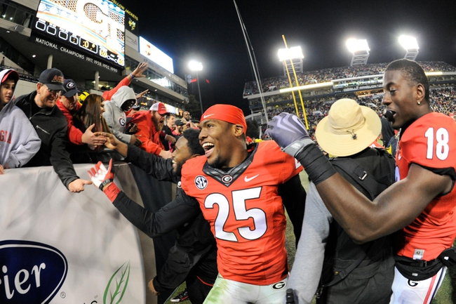 Nov 30, 2013; Atlanta, GA, USA; Georgia Bulldogs players safety Josh Harvey-Clemons (25) celebrates with the fans after defeating the Georgia Tech Yellow Jackets at Bobby Dodd Stadium. Georgia defeated Georgia Tech 41-34 in overtime. Mandatory Credit: Dale Zanine-USA TODAY Sports